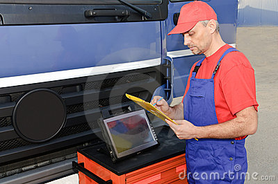 Engineer using diagnostic equipment