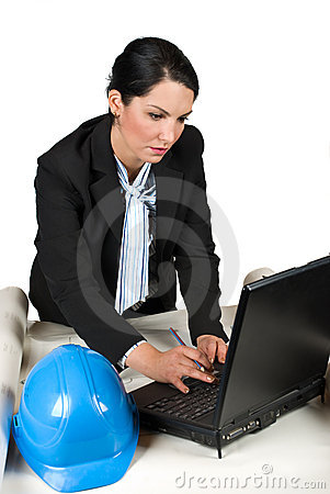 Engineer woman in office with laptop
