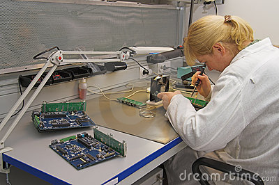 Engineer working with circuits