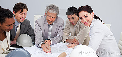 Engineers In A Meeting Studying Plans Stock Photography - Image: 11900562