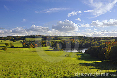 English countryside: green fields, trees and lake