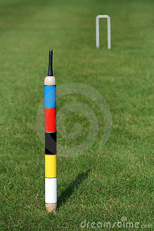 An English croquet lawn, the focus on the centre peg