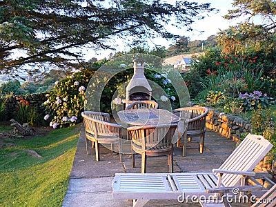 English garden with luxury wooden garden furniture