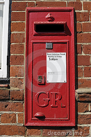 English Red postbox mounted on wall