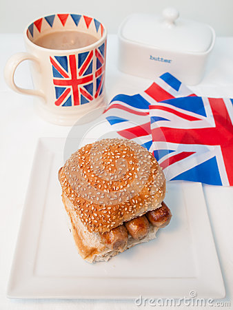 English sausage sandwich withcup of tea and flag