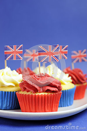 English theme red, white and blue cupcakes with Great Britain Union Jack flags - Close up vertical.