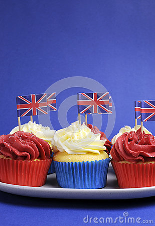 English theme red, white and blue cupcakes with Great Britain Union Jack flags - vertical with copy space.