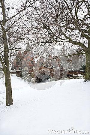 English village bridge in winter snow.