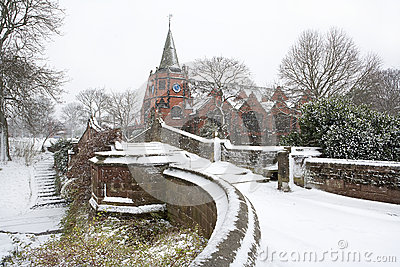 English village bridge in winter snow.