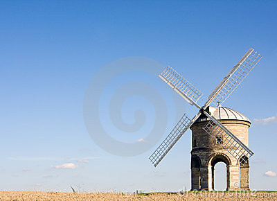 English windmill in summer with blue skies