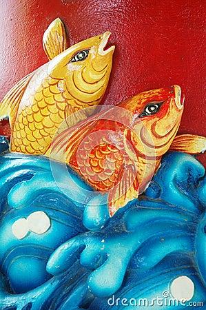 Engraved stone fish