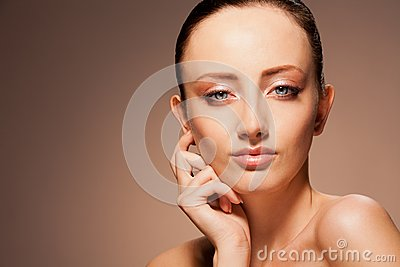Enigmatic woman on chocolate background