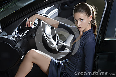 Enigmatic woman sitting inside the car