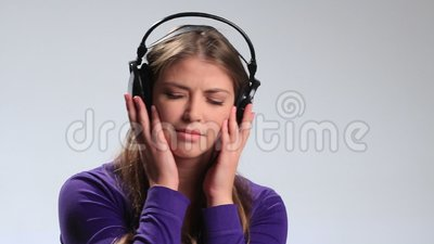 Enjoying her favorite music in earphones stock video footage