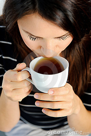 Enjoying her tea