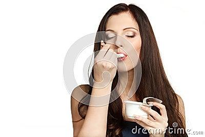 Enjoying taste of yogurt