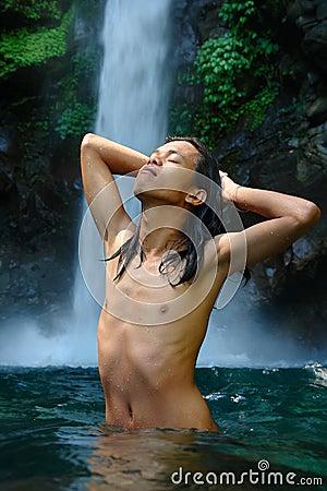 Enjoying a tropical waterfall