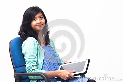 Isolated smiling young business woman holding her tablet pc