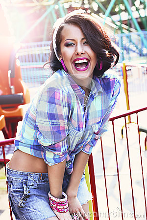 Enjoyment. Gladness. Expressive Woman in Checkered Shirt with Toothy Smile