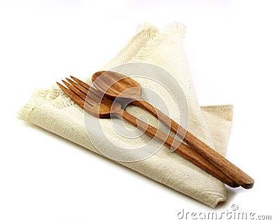Ensemble de tableau fourchette en bois et cuill re sur la serviette d 39 isolement sur le backg - Le coup de la cuillere en bois ...