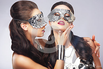 Entertainment. Women in Silver Shiny Masks. Artistry