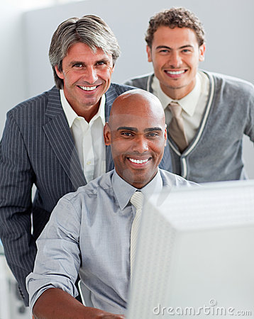 Free Enthusiastic Business Team Working At A Computer Stock Image - 12975691