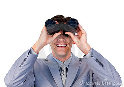 Enthusiastic businessman holding binoculars