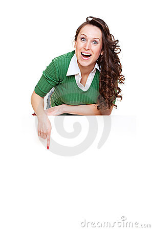 Enthusiastic woman pointing at copyspace