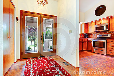 Entrance hallway with glass door stock photo image 47580333 for Bright red kitchen cabinets