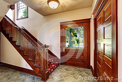 Entrance hallway with wooden staircase