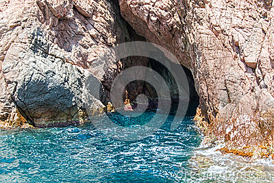 Entrance to sea cave on shoreline of Costa Brava Catalonia