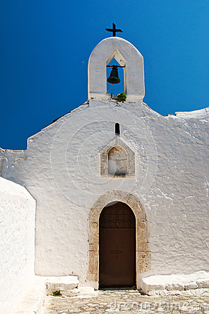 Entrance into the traditional white church, Greece