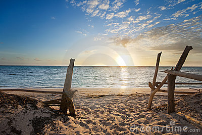 Entry to isolated beach at sunrise Stock Photo
