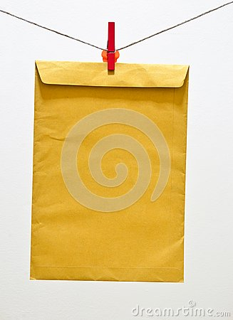 Envelope and green clothespin