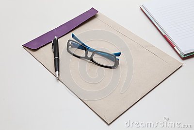 Envelope pen and glasses normal object in working