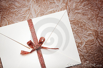 envelope with a red ribbon