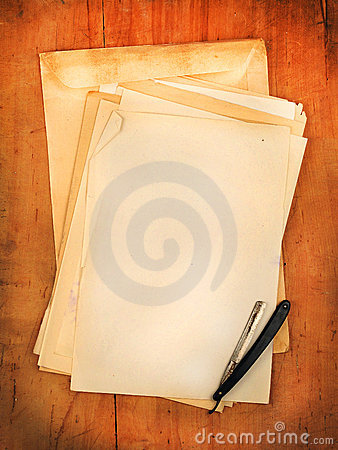 Envelopes with razor as background