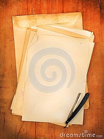 Envelopes with razor as background