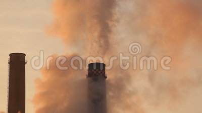 Environment pollution from smoke stacks. Smoke stacks causing environment pollution stock video footage