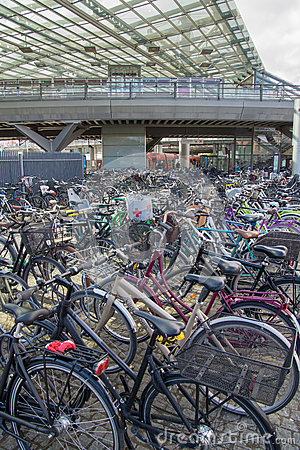 Free Environmentally Friendly Transportation: Parked Bikes In Front Of Train Station, Copenhagen, Denmark Royalty Free Stock Photo - 93815455