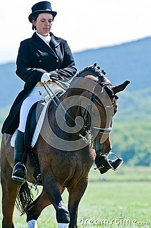 Equestrian sport. Female dressage rider Editorial Image