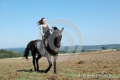 Equestrienne und Pferd.