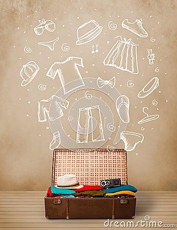 Equipaje del viajero con ropa e iconos dibujados mano