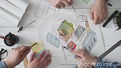 Equipe da engenharia que trabalha em um conceito da energia renovável filme