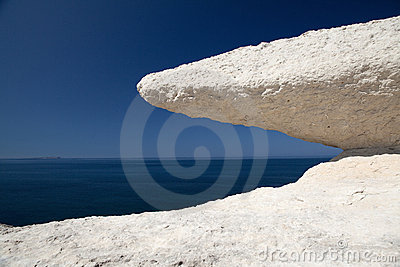 Eroded chalk rock white stone blue sky and sea
