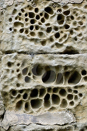 Eroded stone wall