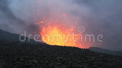 Eruption active Tolbachik Volcano on Kamchatka. Russia, Far East. Beautiful landscape of Kamchatka: eruption active Plosky Tolbachik Volcano - view of lava lake stock footage