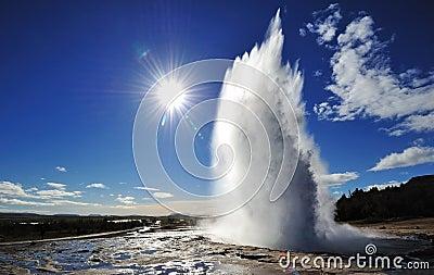 Eruption of Strokkur Geyser with sun burst