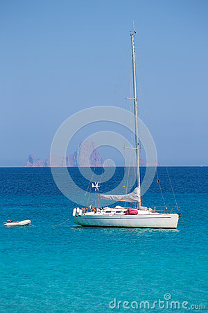 Es Vedra background with sailboat from Formentera