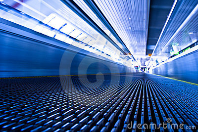 Escalator in blue corridor in trade centre